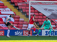 24th April 2021, Oakwell Stadium, Barnsley, Yorkshire, England; English Football League Championship Football, Barnsley FC versus Rotherham United; Michael Smith of Rotherham strikes but is blocked by Callum Styles of Barnsley
