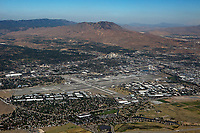 aerial photograph of Reno-Tahoe International Airport (RNO),  Reno, Washoe County, Nevada, downtown Reno in the background