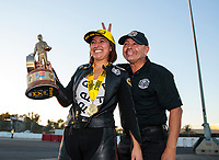 Nov 17, 2019; Pomona, CA, USA; NHRA pro stock motorcycle rider Jianna Salinas celebrates with father Mike Salinas after winning the Auto Club Finals at Auto Club Raceway at Pomona. Mandatory Credit: Mark J. Rebilas-USA TODAY Sports