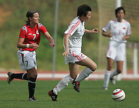 MAR 15, 2006: Albufeira, Portugal:  Yue Guo, Trine Ronning