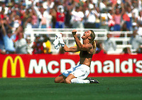 July 10, 1999, Pasadena, California, USA: US midfielder American soccer BRANDI CHASTAIN, 30, drops to her knees, removed her shirt and swung it in triumph above her head. In her black sports bra, and with both fists raised in triumph, looked towards the sky, after making the final and winning goal during penalty kicks. The host United States and China had played to a scoreless draw. After two scoreless overtimes, USA won the match and World Cup 5-4, when Chastain, a righty, fired a surprisingly left-foot penalty kick. As sold out crowd of 90,185 fans, roared, on a hot sweltering 100 degree day, at the Rose Bowl. (Credit Image: © Bildbyran via ZUMA Press)