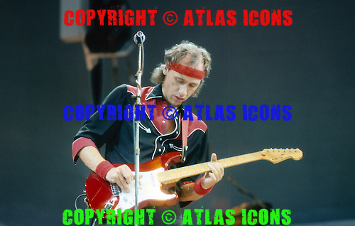 DIRE STRAITS - MARK KNOPFLER PERFORMING  AT LIVE AID , WEMBLEY STADIUM, LONDON, ENGLAND  1985