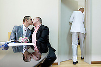 Yaroslav Yevtushenko embraces his boyfriend Dmitry Chunosov at St. Petersburg's registry office where, on 28 June 2013, five same sex couples attempted to officially submit applications to register their marriages. According to media reports all the submissions were rejected by the authorities. On 30 June 2013, Russian President Vladimir Putin signed into law an ambiguous bill banning the 'propaganda of nontraditional sexual relations to minors'. The law met with widespread condemnation from human rights and LGBT groups. (MANDATORY CREDIT   photo: Mads Nissen/Panos Pictures /Felix Features)