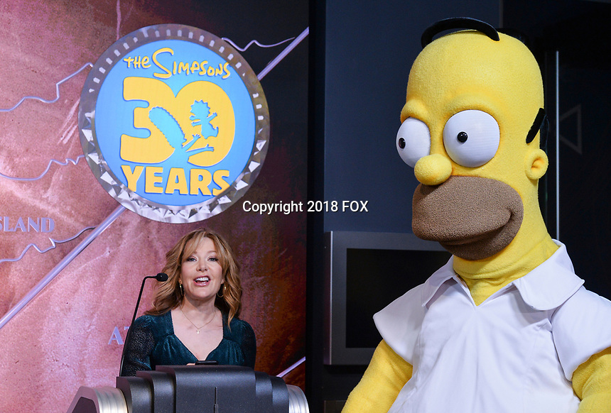 """New York - DECEMBER 17: Stephanie Gillis speaks to the media as he participates in the ceremonial lighting of the Empire State Building as they attend the Empire State Building Celebration of the 30th Anniversary of FOX's """"The Simpsons"""" on December 17, 2018 in New York City.  (Photo by Anthony Behar/FOX/PictureGroup)"""