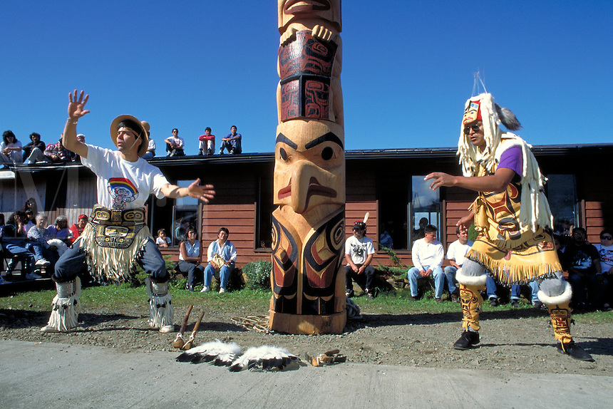 Tsimshian totem pole carvers, dances in front of a pole, Metlakatla, Alaska.