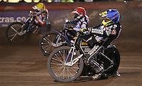 Heat 13: Lewis Bridger (blue), Peter Karlsson (red) and Patrick Hougaard (yellow) - Lakeside Hammers vs Leicester Lions, Elite League Speedway at the Arena Essex Raceway, Pufleet - 04/04/14 - MANDATORY CREDIT: Rob Newell/TGSPHOTO - Self billing applies where appropriate - 0845 094 6026 - contact@tgsphoto.co.uk - NO UNPAID USE