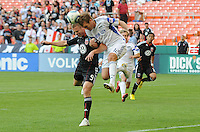 Kansas City Wizards defender Jimmy Conrad (12) heads the ball  against DC United forward Danny Allsopp (9).   DC United defeated The Kansas City Wizards  2-0 at RFK Stadium, Wednesday  May 5, 2010.