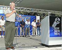 With 1970's and 1980's era San Jose Earthquakes players in the background,  former player and general manager Johnny Moore speaks to a crowd of approximately 1,500 Earthquakes fan gathered at the Soccer Silicon Valley Rally held in downtown San Jose, CA on August 20, 2004 to show support for the club.  The non-profit Soccer Silicon Valley group hope to find a local buyer or soccer specific stadium for the Earthquakes within the next month so the team is not relocated to San Antonio or Houston, TX by its current investor/operator Anschutz Entertainment Group.