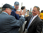 16 May 09:  Assistant Trainer Scott Blasi (right) gets a high-five after Rachel Alexandra won the Preakness Stakes at Pimlico Race Course in Baltimore, Maryland on Preakness Day.