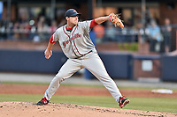 Greenville Drive starting pitcher Mike Shawaryn (24) delivers a pitch during a game against the Asheville Tourists at McCormick Field on April 13, 2017 in Asheville, North Carolina. The Tourists defeated the Drive 3-1. (Tony Farlow/Four Seam Images)