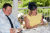 Guests studying the formbook in the Corinthian Sports hospitality boxes during the The Coronation Stakes Day of Royal Ascot 2017 at Royal Ascot Racecourse on Friday 23rd June 2017 (Photo by Rob Munro/Stewart Communications)