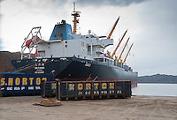 Bulker ship Dayahai from Hong Kong being loaded with scrap metal at Liverpool docks.