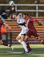 Virginia Tech defender Drew Ranahan (3) attempts to head a corner kick as Boston College midfielder Giuliano Frano (15) defends.Boston College (maroon) defeated Virginia Tech (Virginia Polytechnic Institute and State University) (white), 3-1, at Newton Campus Field, on November 3, 2013.