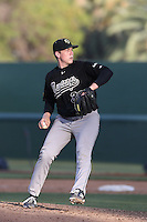 Slater Lee #36 of the Cal Poly Mustangs pitches against the UCLA Bruins at Jackie Robinson Stadium on February 22, 2014 in Los Angeles, California. Cal Poly defeated UCLA, 8-0. (Larry Goren/Four Seam Images)