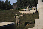 """American soldiers with Delta Company, 2nd Battalion, 7th Infantry Regiment, 1st Armored Brigade Combat Team, 3rd Infantry Division in M1A2 Abrams tanks during a tank training exercise practicing infiltration at the Drawsko Pomorskie Training Area in Poland on June 12, 2015.    NATO is engaged in a multilateral training exercise """"Saber Strike,"""" the first time Poland has hosted such war games, involving the militaries of Canada, Denmark, Germany, Poland, and the United States."""