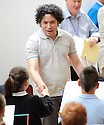 Gustavo Dudamel meets the kids from the Raploch Orchestra at the start of today's rehearsal ........