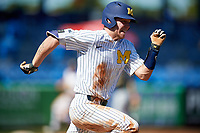 Michigan Wolverines designated hitter Dominic Clementi (13) runs to first base during a game against Army West Point on February 18, 2018 at Tradition Field in St. Lucie, Florida.  Michigan defeated Army 7-3.  (Mike Janes/Four Seam Images)