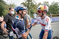 Julian Alaphilippe's (FRA/Deceuninck - Quick Step) first competitor to congratulate him is Tom Pidcock (GBR/INEOS Grenadiers)<br /> <br /> Elite Men World Championships - Road Race<br /> from Antwerp to Leuven (268.3km)<br /> <br /> UCI Road World Championships - Flanders Belgium 2021<br /> <br /> ©kramon