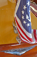 American flag and chrome fittings on Century wooden boat. Lake Tahoe. California