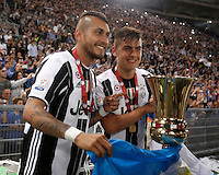Calcio, finale Tim Cup: Milan vs Juventus. Roma, stadio Olimpico, 21 maggio 2016.<br /> Juventus' Roberto Pereyra, left, and Paulo Dybala hold the trophy at the end of the Italian Cup final football match between AC Milan and Juventus at Rome's Olympic stadium, 21 May 2016. Juventus won 1-0 in the extra time.<br /> UPDATE IMAGES PRESS/Isabella Bonotto