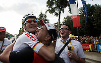 André Greipel (DEU/Lotto-Soudal) is overjoyed and is hugging his soigneur/friend Raoul Saren after his first (but most prestigeous) sprint finish (on the Champs-Elysées) this Tour, copy-ing last years victory.<br /> <br /> Final stage 21 - Chantilly › Paris (113km)<br /> 103rd Tour de France 2016
