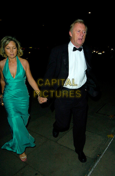 CHRIS TARRANT & guest.At The Paul O'Gorman Banquet & Ball, Grosvenor House Hotel, Park Lane, London, England, November 10th 2007..full length black bow tie suit Green dress holding hands.CAP/CAN.©Can Nguyen/Capital Pictures