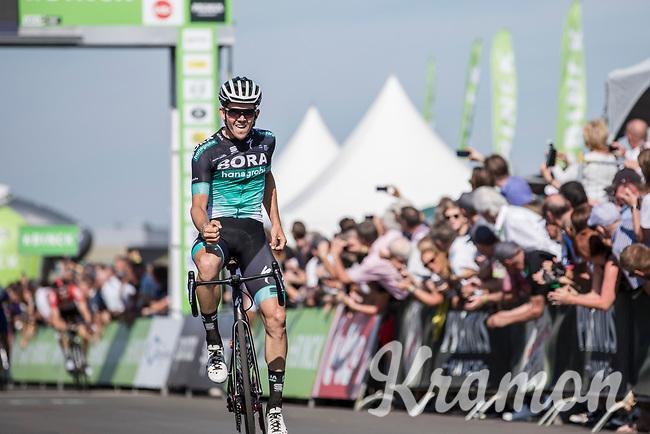 stage winner Gregor Mühlberger (AUT/Bora Hansgrohe) crossing the finish line .<br /> <br /> Binckbank Tour 2018 (UCI World Tour)<br /> Stage 6: Riemst (BE) - Sittard-Geleen (NL) 182,2km