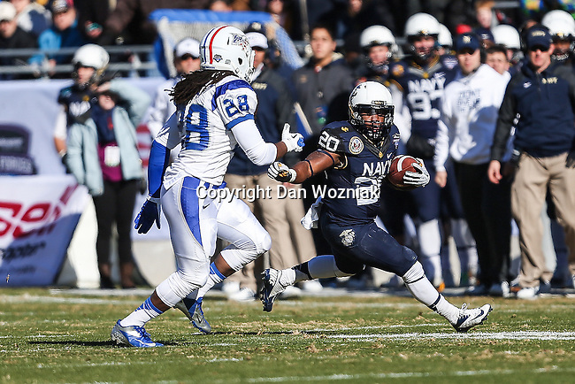 Navy Midshipmen running back Darius Staten (20) in action during the Armed Forces Bowl game between the Middle Tennessee Blue Raiders and the Navy Midshipmen at the Amon G. Carter Stadium in Fort Worth, Texas. Navy defeated Middle Tennessee 24 to 6.