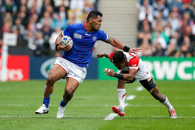 Samoa Inside Centre Johnny Leota is tackled by Japan Winger Kotaro Matsushima - Mandatory byline: Rogan Thomson - 03/10/2015 - RUGBY UNION - Stadium:mk - Milton Keynes, England - Samoa v Japan - Rugby World Cup 2015 Pool B.