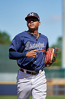 Mississippi Braves center fielder Cristian Pache (16) jogs to the dugout during a Southern League game against the Jacksonville Jumbo Shrimp on May 5, 2019 at Trustmark Park in Pearl, Mississippi.  Mississippi defeated Jacksonville 1-0 in ten innings.  (Mike Janes/Four Seam Images)