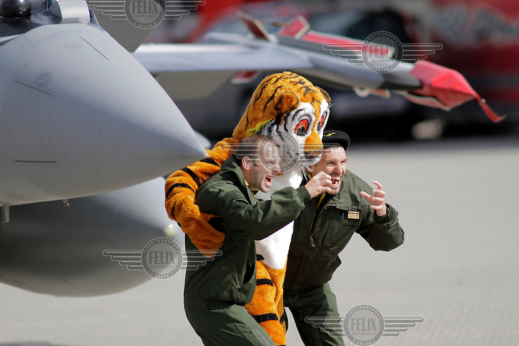 French aircrew pose with a tiger during Tiger Air show.  Nato Tiger Meet is an annual gathering of squadrons using the tiger as their mascot. While originally mostly a social event it is now a full military exercise. Tiger Meet 2012 was held at the Norwegian air base Ørlandet.