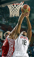 Eric GORDON (USA) jumps for the ball with Sergey MONYA (Russia) during the quarter-final World championship basketball match against Russia in Istanbul, USA-Russia, Turkey on Thursday, Sep. 09, 2010..