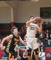 NWA Democrat-Gazette/J.T. WAMPLER Pea Ridge's Britton Caudill goes up for a shot while Prairie Grove's Nick Ellis defends Tuesday Feb. 2, 2016. Pea Ridge won 57-29. For a gallery of game images go to: http://nwamedia.photoshelter.com/