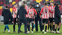 Brentford Manager, Thomas Frank, congratulates  Tariqe Fosu, scorer of their winning goal, at the final whistle  during Brentford vs AFC Bournemouth, Sky Bet EFL Championship Football at the Brentford Community Stadium on 30th December 2020