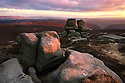 The Barrow Stones at sunset, an outcrop of gritstone. Peak District National Park, Derbyshire, UK. January.