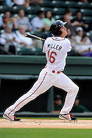 Right fielder Derek Miller (16) of the Greenville Drive bats in a game against the Augusta GreenJackets on Opening Day, Thursday, April 9, 2015, at Fluor Field at the West End in Greenville, South Carolina. (Tom Priddy/Four Seam Images)