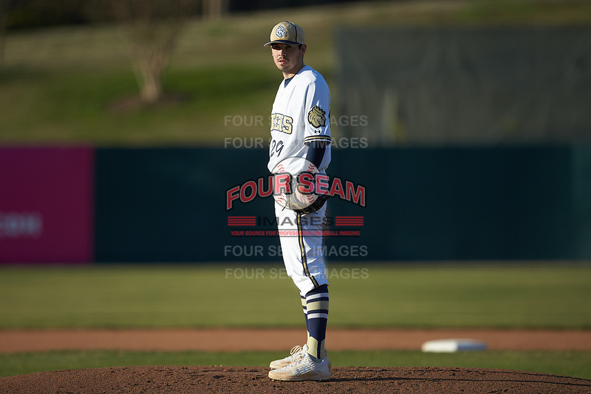 Queens Royals starting pitcher Kollin Schrenk (29) looks to his catcher for the sign against the Barton Bulldogs at Intimidators Stadium on March 19, 2019 in Kannapolis, North Carolina. The Royals defeated the Bulldogs 6-5. (Brian Westerholt/Four Seam Images)