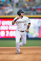 Juan Diaz (17) of the Charlotte Knights hustles towards third base against the Chicago White Sox at BB&T Ballpark on April 3, 2015 in Charlotte, North Carolina.  The Knights defeated the White Sox 10-2.  (Brian Westerholt/Four Seam Images)