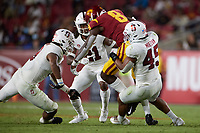 LOS ANGELES, CA - SEPTEMBER 11: Ricky Miezan #45, Levani Damuni #3 and Kendall Williamson #21 of the Stanford Cardinal tackle Michael Trigg #8 of the USC Trojans during a game between University of Southern California and Stanford Football at Los Angeles Memorial Coliseum on September 11, 2021 in Los Angeles, California.