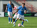 Hamilton Academical St Johnstone....04.04.15<br /> Chris Millar gets away from Nigel Hasselbaink<br /> Picture by Graeme Hart.<br /> Copyright Perthshire Picture Agency<br /> Tel: 01738 623350  Mobile: 07990 594431