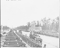 British Prime Minister Winston Churchill passes the parade of Bren carriers belonging to the Canadian contingent, July 15, 1945