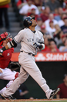 Robinson Cano #24 of the New York Yankees bats against the Los Angeles Angels at Angel Stadium on May 29, 2012 in Anaheim,California. Los Angeles defeated New York 5-1.(Larry Goren/Four Seam Images)