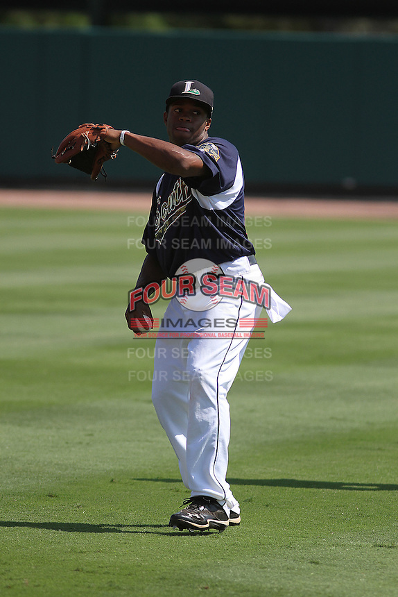 Lexington Legends infielder Delino DeShields Jr. throwing in the outfield before the South Atlantic League All-Star game held at the Joseph P. Riley Jr.Ballpark in Charleston, South Carolina on June 19th, 2012.  The Northern division defeated the Southern division by the score of 3-2. (Robert Gurganus/Four Seam Images)