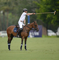 WELLINGTON, FL - MAY 04: (EXCLUSIVE COVERAGE)  Prince Harry seems to be signaling he is not happy as he participates in the Sentebale Polo Cup Presented By Royal Salute World Polo and held at Valiente Polo Farm In Wellington Florida on May 4, 2016 in Wellington, Florida.<br /> <br /> People:  Prince Harry