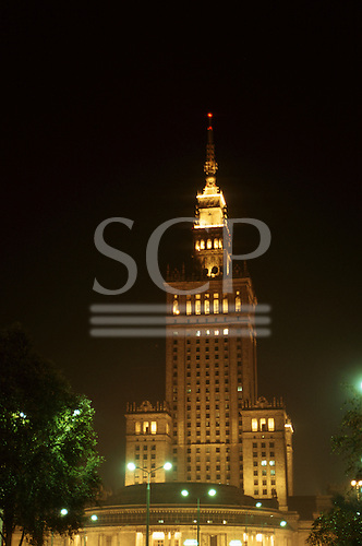 Warsaw, Poland; building from Stalin era lit up at night.