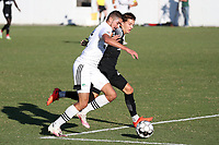 RICHMOND, VA - SEPTEMBER 30: Manny Perez #2 of North Carolina FC tries to push past John Tolkin #47 of New York Red Bulls II during a game between North Carolina FC and New York Red Bulls II at City Stadium on September 30, 2020 in Richmond, Virginia.