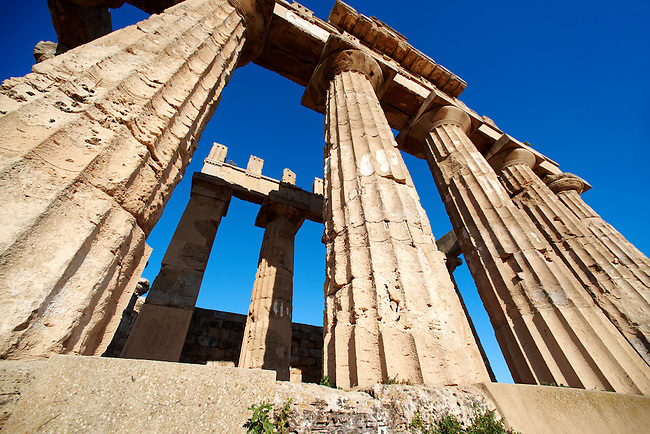 Greek Dorik columns at the  ruins of Temple F at Selinunte, Sicily photography, pictures, photos, images & fotos. 71 Greek Dorik Temple columns of the ruins of the Temple of Hera, Temple E, Selinunte, Sicily