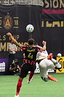 ATLANTA, GA - AUGUST 29: Anton Walkes #4 of Atlanta United and Daryl Dike #18 of Orlando City compete for the ball during a game between Orlando City SC and Atlanta United FC at Marecedes-Benz Stadium on August 29, 2020 in Atlanta, Georgia.