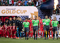 CHICAGO, IL - JULY 7: The teams are lead out on the field by the referees during a game between Mexico and USMNT at Soldiers Field on July 7, 2019 in Chicago, Illinois.