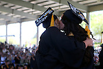 Mother and daughter graduates Bethany Deacy, left, and Tamara Perez hug onstage during the 2013 Western Nevada College Commencement at the Pony Express Pavilion, in Carson City, Nev., on Monday, May 20, 2013. .Photo by Cathleen Allison